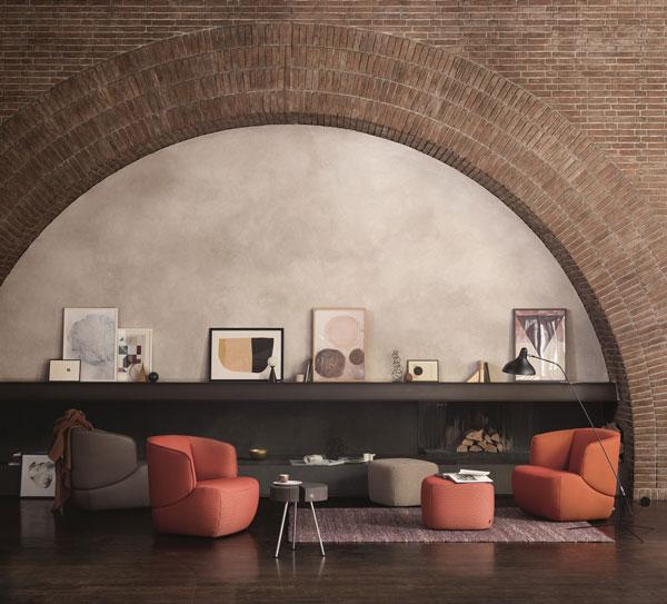 Wohnzimmer mit orangenen Rolf Benz Sessel